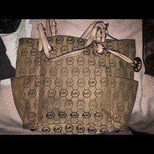 Medium sized Michael Kors tote purse